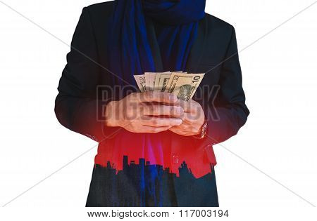 Businessman holding cash with silhouette city background, abstract concept, isolated on white backgr