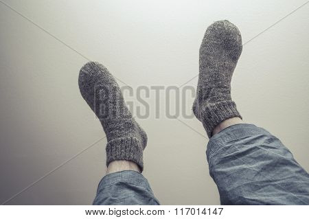 Male Feet In Gray Woolen Socks, Retro Style