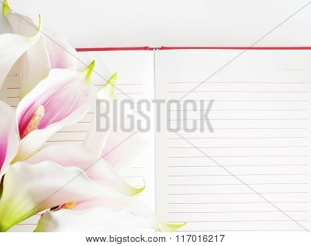 Open Notebook And Beautiful Calla Artificial Pink Flowers Bouquet