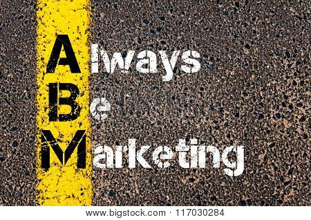 Concept image of Business Acronym ABM ALWAYS BE MARKETING written over road marking yellow paint line. poster