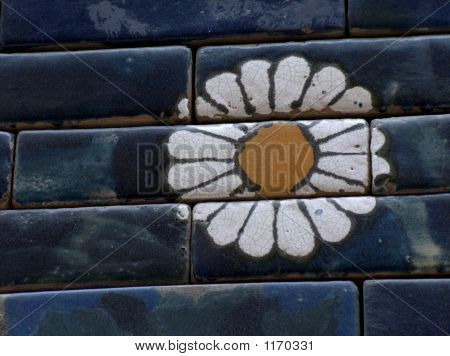 Close Up Of A Flower Painted On Blue Brick Wall