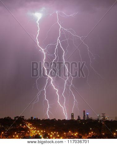 Huge Lightning strikes over Melbourne city skyline. poster