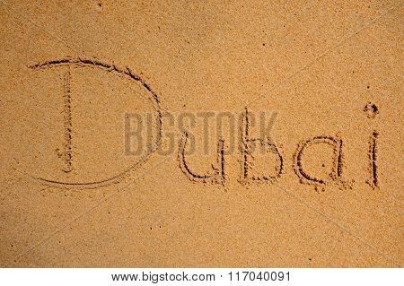 Dubai Sign On The Beach Sand