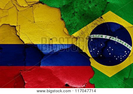 Flags Of Colombia And Brazil Painted On Cracked Wall