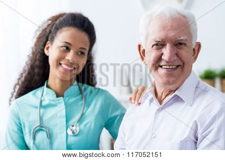 Afroamerican Caregiver And Old Man