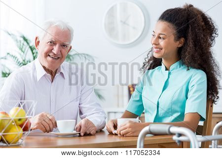 Image of positive afroamerican carer and retired man poster