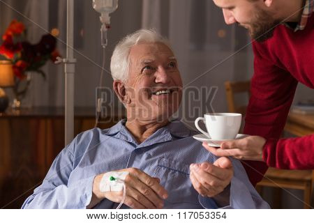 Carer Assisting Incurable Ill Man