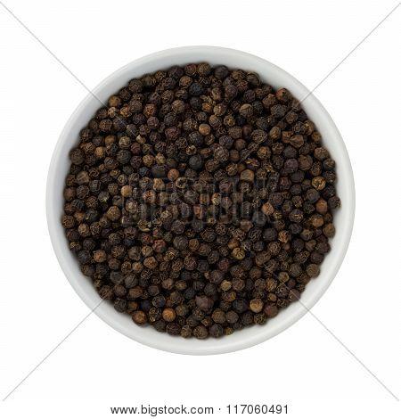 Whole Black Pepper In A Ceramic Bowl