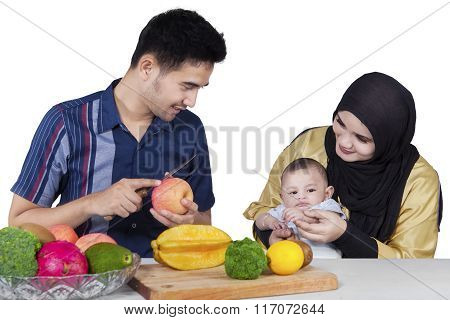 Happy Family Preparing A Meal