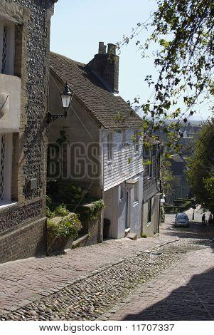 Steep cobblestone street known as Keere Street. Lewes. East Sussex. England poster