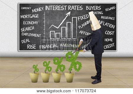 Man With Percentage Sign Of Interest Rates
