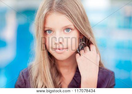 Blonde teen girl over blue