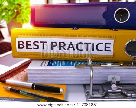 Best Practice - Yellow Ring Binder on Office Desktop with Office Supplies and Modern Laptop. Best Practice Business Concept on Blurred Background. Best Practice - Toned Illustration. 3D Render. poster
