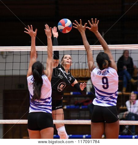 KAPOSVAR, HUNGARY - JANUARY 17: Kitti Szombathelyi (black) in action at the Hungarian I. League volleyball game Kaposvar (black) vs Ujpest (white), January 17, 2016 in Kaposvar, Hungary.