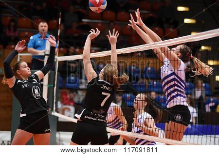 KAPOSVAR, HUNGARY - JANUARY 17: Andrea Jenei posts the ball at the Hungarian I. League volleyball game Kaposvar (black) vs Ujpest (white), January 17, 2016 in Kaposvar, Hungary.