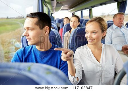happy couple or passengers in travel bus