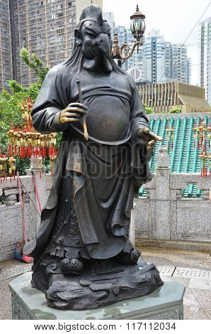 Hong Kong, China - June 25, 2014: Chinese Zodiac Bronze Rooster Stature At Sik Sik Yuen Wong Tai Sin