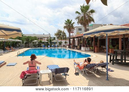 Vacationers relaxing at the pool in Rhodes Greece