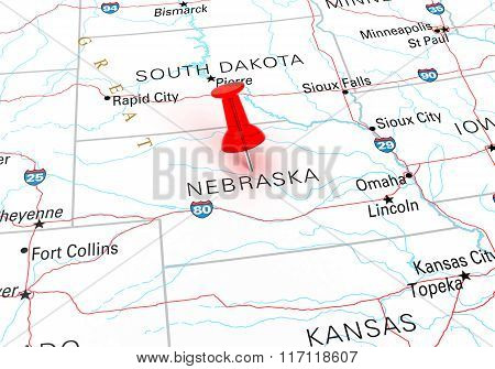 Red Thumbtack Over Nebraska State Usa Map