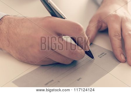 Businessman Writing A Payment Check