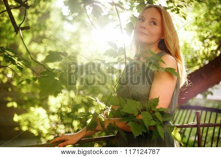 Young Romantic Meditative Woman In Summer