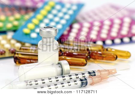 Injection Medication With Pills Strips Background.