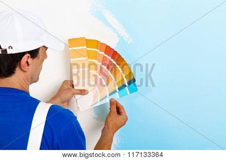 Painter Man Looking A Color Palette