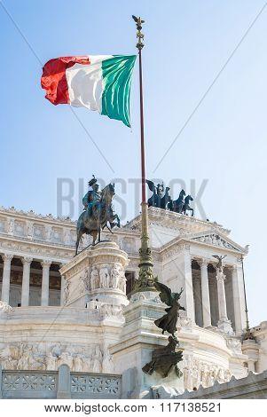 View of Italian national flag in front of Altare della Patria