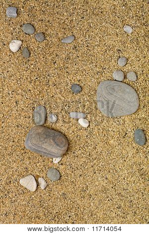 Rocks And Stones Over The Sand