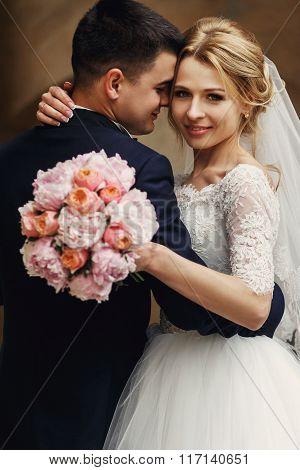 Happy Sensual Handsome Groom And Blonde Beautiful Bride In White Dress Hugging Closeup