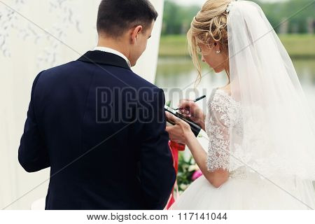 Beautiful Happy Blonde Bride Taking Vows With Handsome Groom Close-up
