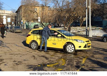 Moscow - November 28, 2015: A Taxi Driver Washing His Car On The Street
