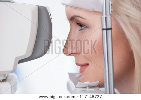 Pretty young woman is visiting eye doctor