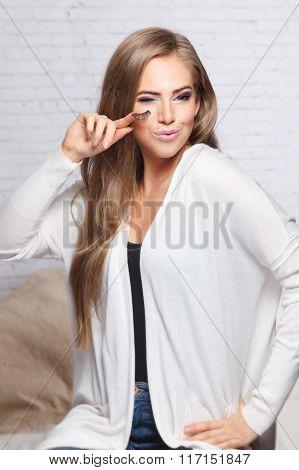 Sexy Woman Holding Fake Eyelashes