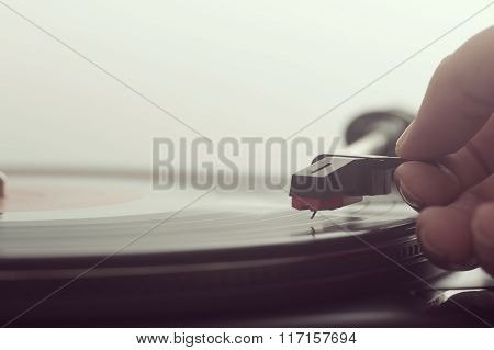 Man Putting A Vinly Record On Turntable