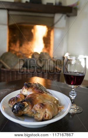 Red Wine Goblet And Roast Piglet In Front Thefireside