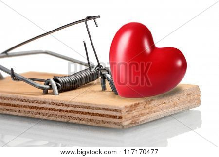Mousetrap with red heart isolated on white