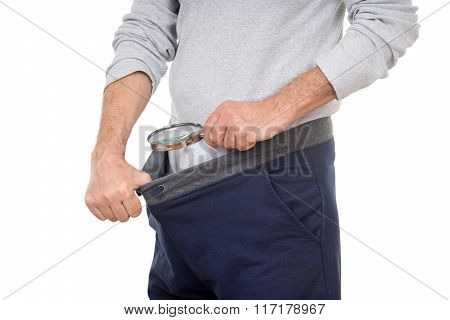 Man With Magnifying Glass Looking Into His Tracksuit Pants