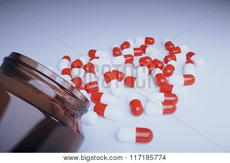 Brown Bottle With Red And White Pills