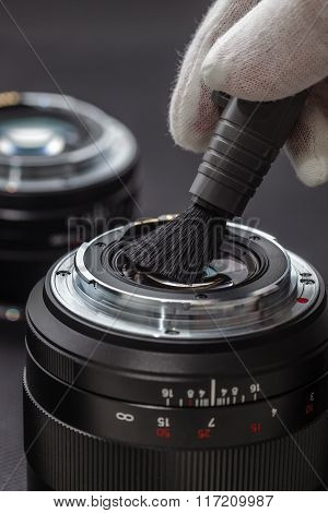 Man Cleans The Lens From Accumulated Dirt And Dust