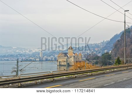 VEYTAUX SWITZERLAND - JANUARY 2 2015: View to Chillon Castle from the road. It is an island castle on Lake Geneva (Lac Leman) in the Vaud between Montreux and Villeneuve.