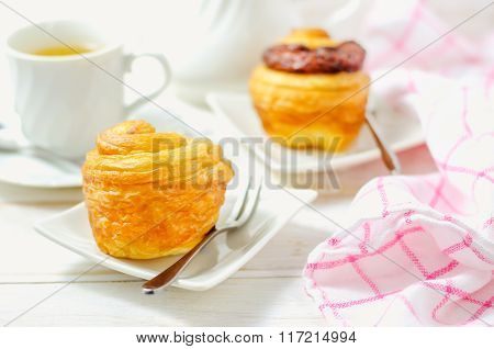 Mini Cruffin(croissant And Muffin) In White Dish With Cup Of Tea