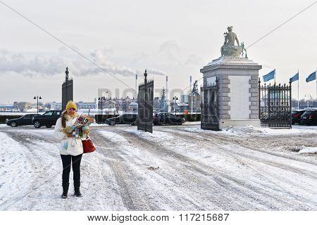 Girl Holding Map At Langelinie Park Gate In Winter Copenhagen