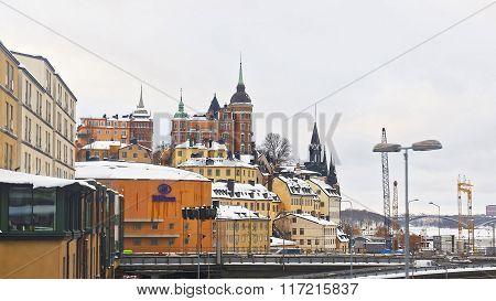 STOCKHOLM, SWEDEN - JANUARY 5, 2011: Northern Sodermalm and bridge to Riddarholmen in winter Stockholm. Sodermalm is a city district area in central Stockholm Sweden. Selective focus.