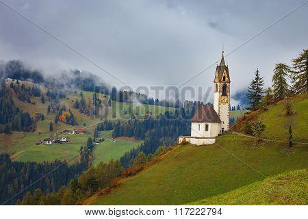 Romantic church in fog, La Valle - Wengen