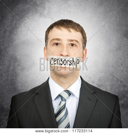 Businessman with tape over his mouth