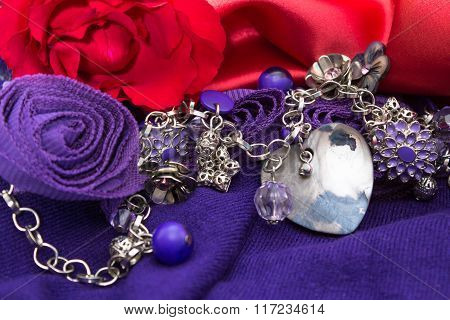 Valentine Red And Purple Background With Necklace Mother Of Pearl Heart And Red Rose