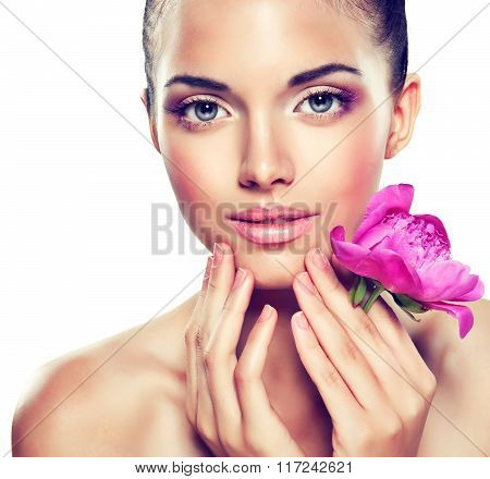 Beauty Portrait. Beautiful Spa Woman Touching her Face .  Cosmetics and cosmetology.
