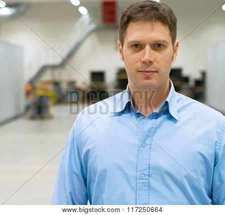 Portrait Of Handsome Supervisor At Warehouse.