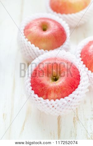 Red Apples On White Wooden Table